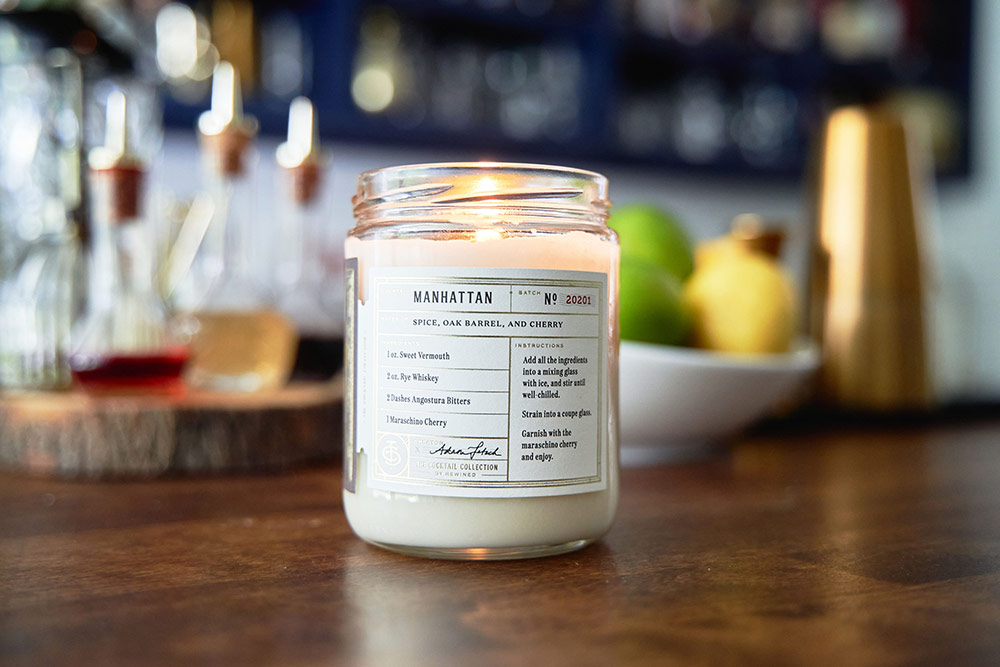 A sweet smelling candle helps set the atmosphere at a cocktail party